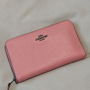 Pink coach wallet.